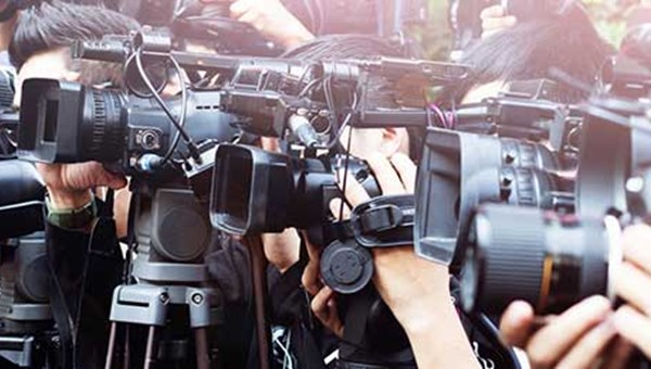 Photo of press with cameras