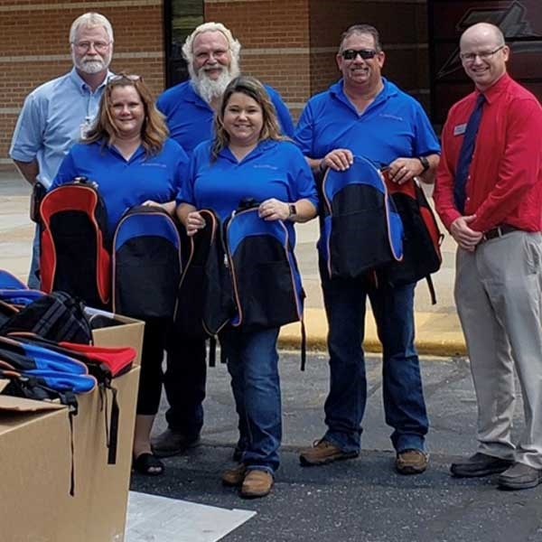 Land Systems Employees Send Kids Back to School Well Supplied