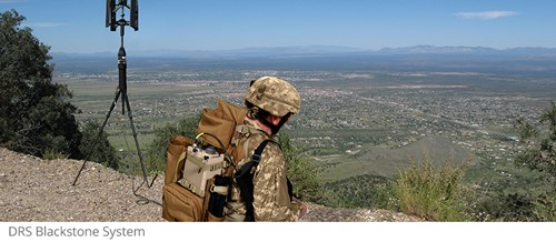 soldier looking over cliff view