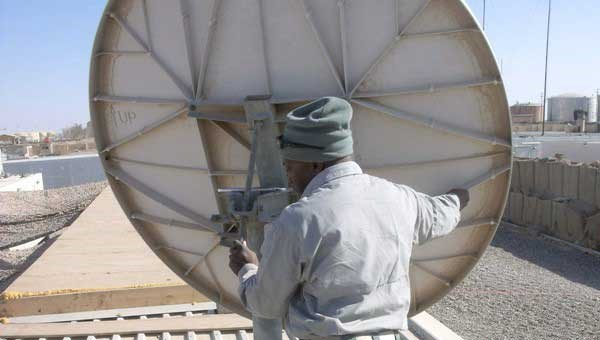 man fixing satellite dish